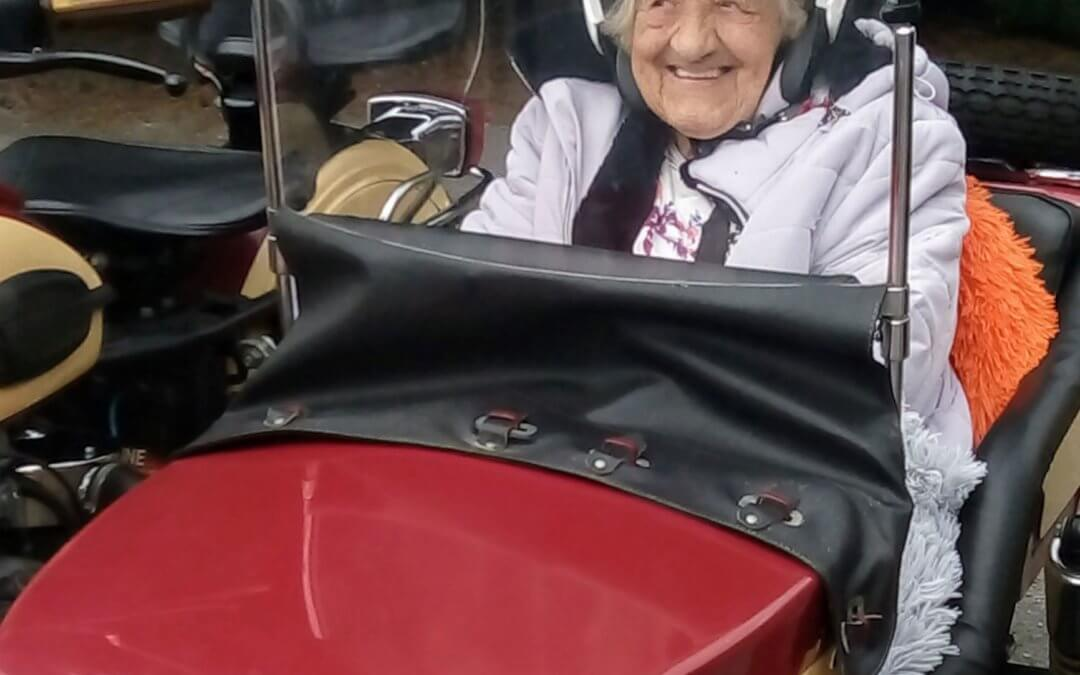 "Gladys ""Never in a million years did I think when I woke up this morning would I be riding in a side car again, I didn't think they did things like this in care homes, I am so happy"