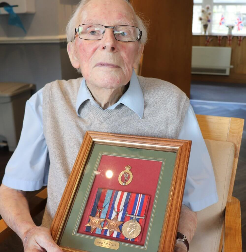 Harold with his D-day Medals at Lavender Hills care home